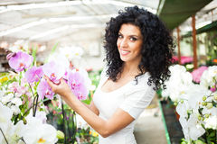 Woman looking to orchids Royalty Free Stock Photo