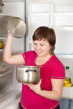 Woman looking in to pan from  refrigerator Royalty Free Stock Photo
