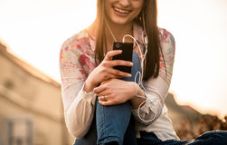 Woman looking to phone in street Royalty Free Stock Images