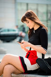 Woman looking to phone in street Royalty Free Stock Photos