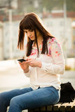 Woman looking to phone Royalty Free Stock Photography