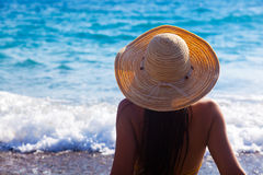 A woman is looking to the sea Royalty Free Stock Image
