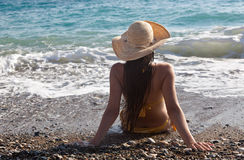 A woman is looking to the sea Stock Images
