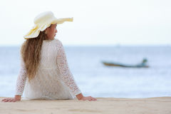 Woman looking at to sea, vintage style looking Stock Images