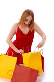 Woman looking in to shopping bag. Royalty Free Stock Photography