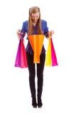 Woman looking to shopping bag Stock Photos