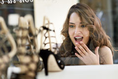 Woman looking to showcase or shop window Royalty Free Stock Photo