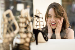 Woman looking to showcase or shop window Royalty Free Stock Images