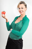 Woman looking at tomato Stock Image
