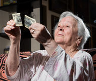 Woman looking at torn one hundred dollar bill Royalty Free Stock Photo
