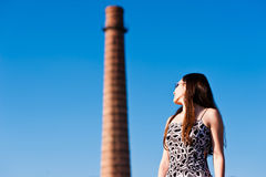 Woman looking at the tower. Beautiful woman looks at an old tower Royalty Free Stock Photo