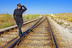 Woman looking for the train Royalty Free Stock Photo