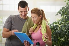 Woman looking at training plan Royalty Free Stock Photography