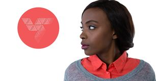Woman looking at triangle shapes in circle. Digital composite of Woman looking at triangle shapes in circle Stock Photo