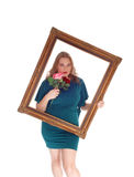 Woman looking trough picture frame Royalty Free Stock Images