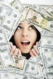 Woman looking trought hole on money bacground Royalty Free Stock Images