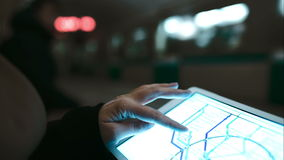 Woman looking at underground map using touch pad stock video