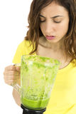 Woman looking unhappy about the green smoothie Stock Images