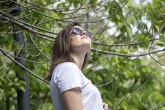 Woman looking up at the city park royalty free stock images