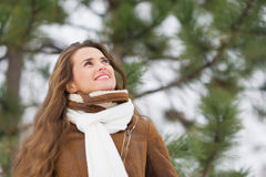 Woman looking up on copy space in winter outdoors Stock Photography