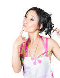 Woman looking up high with a thinking expression. Cheerful woman wearing housewife apron looking up high with a thinking expression. Copy space concept Royalty Free Stock Photos