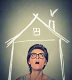 Woman looking up house roof above head Royalty Free Stock Photos