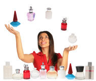Woman looking up and juggling perfumes. Collage Stock Images