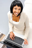 Woman looking up with laptop Stock Photo