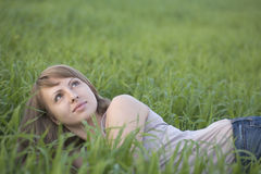 Woman Looking Up While Lying On Grass Royalty Free Stock Image