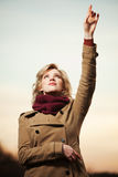 Woman looking up and pointing in the sky Stock Photography
