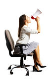 Woman looking up and screaming at megaphone Stock Photos
