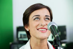 Woman Looking Up While Singing In Recording Studio Royalty Free Stock Image