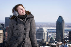 Woman looking up at sky with cityscape behind Stock Photography