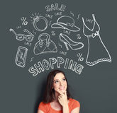 Woman looking up thinking of buying or shopping something. Portrait of Happy young woman looking up thinking of buying or shopping something Stock Photography
