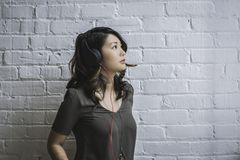 Woman Looking Up While Wearing Headphones royalty free stock images