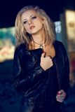 Woman looking up wearing leather jacket Royalty Free Stock Photo