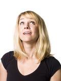 Woman looking upwards. Portrait of a woman looking upwards Stock Photos