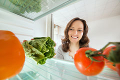 Woman Looking At Vegetables View From Inside Fridge Stock Images