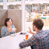 Woman looking very upset towards the man accross from her Royalty Free Stock Image