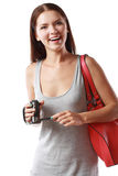 Woman looking at videocamera. Beautiful woman looking at videocamera shooted something interesting outside te picture Stock Image