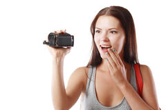 Woman looking at videocamera Royalty Free Stock Image