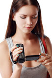 Woman looking at videocamera. Beautiful woman looking at videocamera shooted something interesting outside te picture Stock Photography