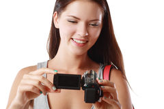 Woman looking at videocamera. Beautiful woman looking at videocamera shooted something interesting outside te picture Royalty Free Stock Image
