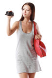 Woman looking at videocamera. Beautiful woman looking at videocamera shooting something outside te picture Royalty Free Stock Images