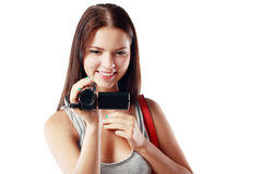 Woman looking at videocamera. Beautiful woman looking at videocamera shooting something outside te picture Royalty Free Stock Photos