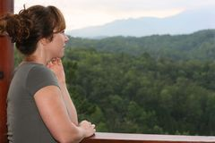 Woman looking at view of mountains Stock Photo