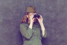 Woman looking through vintage binoculars Stock Photos