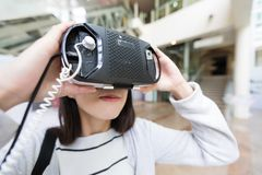 Woman looking with virtual reality. Asian young pretty woman at outdoor Stock Images