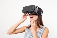 Woman looking with VR device and feeling excite. Asian young woman Stock Photos