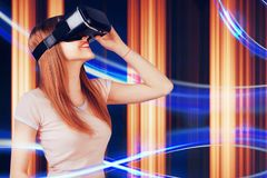 Woman looking with VR device and feeling excite and smile. Girl with glasses of virtual reality. Future technology concept. Abstract lines on background Royalty Free Stock Photo